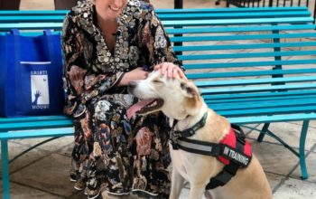 Kristi House CEO, Amanda G. Altman, with Pedro the Facility Dog.